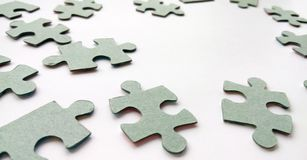 Abstract grey jigsaw puzzle pieces on white background stock photo