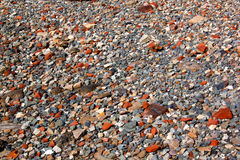 Abstract Grey Stones and Red Clay Brick Pieces Stock Photography