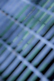 Abstract grid. Close-up of an out of focus purple-blue metal grid Royalty Free Stock Photos