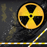 Abstract grunge background. Abstract grunge background with the emblem of radiation. Illustration for your design Royalty Free Stock Image