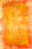 Abstract grunge background. In yellow and orange tones Stock Image