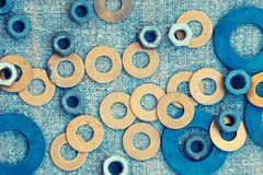 Abstract grunge background. Metallic rings washers on sackcloth Stock Photos