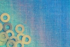 Abstract grunge background. Metallic rings washers on sackcloth Royalty Free Stock Images
