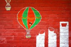Abstract grunge background - red brick wall and hot air balloon and shanghai`s modern bulidings graffiti. This image can be used as a background. It also can be Royalty Free Stock Photo