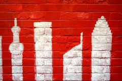 Abstract grunge background - red brick wall and shanghai`s morden buliding graffiti Stock Photos