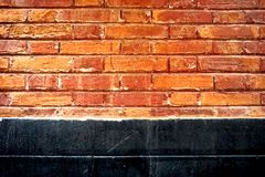 Abstract grunge background - red and yellow brick wall and black wall. The grunge background is red and yellow wall and black wall. This image can be used as a Stock Images