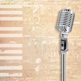 Abstract grunge background with retro microphone Stock Photo