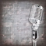 Abstract grunge background with retro microphone Royalty Free Stock Photo