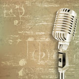 Abstract grunge background with retro microphone Stock Image
