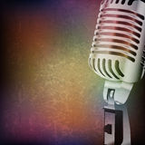 Abstract grunge background with retro microphone Royalty Free Stock Image