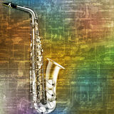 Abstract grunge background with saxophone Stock Photography