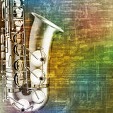 Abstract grunge background with saxophone Stock Images