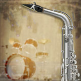 Abstract grunge background saxophone and musical instruments. Abstract music grunge background with saxophone and drum kit Stock Images