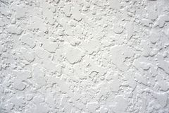 Abstract texture background. The grunge background is white spotted wall. This image can be used as a background. It also can be used as a wallpaper. Of course Stock Photos