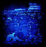 Abstract Grunge Black and Blue Glow Background. Glowing shades of blue on black rough-textured grunge background Stock Photography