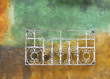 Abstract, grunge, faded painted wall. With rusty metal railing royalty free stock images