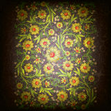 Abstract grunge floral ornament with gold flowers. On black Stock Photography