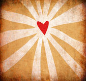 Abstract grunge heart background with sun rays Stock Image