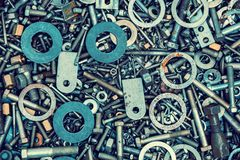 Abstract grunge metallic background. From parts. Mounting screws, bolts, washers Stock Photos