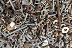 Old rusty screw. Building waste. Abstract grunge metallic background. Old rusty screw. Building waste Stock Photos