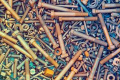 A bunch of old screws of nuts and washers. Abstract grunge metallic background from parts and tools. A bunch of old screws of nuts and washers Royalty Free Stock Photo