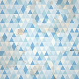 Abstract grunge mosaic background. With blue triangles Stock Images