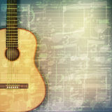 Abstract grunge music background with acoustic guitar. Abstract grunge green cracked music symbols vintage background with acoustic guitar Stock Photography