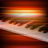 Abstract grunge music background with piano. Abstract red blur music background with piano keys Royalty Free Stock Photos