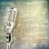 Abstract grunge music background with retro microphone Royalty Free Stock Photos