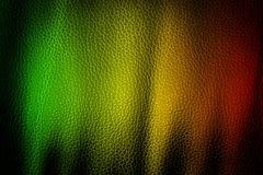 Abstract grunge painted scratched texture background . reggae colors green, yellow, red.  Stock Photos