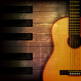 Abstract grunge piano background with acoustic guitar. Abstract brown grunge music background with acoustic guitar Stock Photography