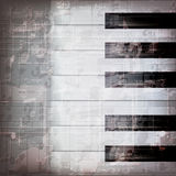 Abstract grunge piano background with piano keys Royalty Free Stock Images