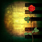 Abstract grunge piano background with red rose. Abstract green grunge music background with red rose Royalty Free Stock Photography