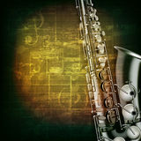 Abstract grunge piano background with saxophone Stock Images