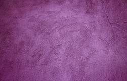 Abstract grunge purple background. With spot light in center of frame and darkened edges, rough texture Stock Image