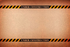 Abstract grunge under construction sign against a Stock Images