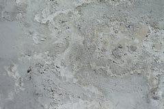 Abstract grungepleister als achtergrond die op muur, abstract grijs patroon op grijs wordt gesmeerd Stock Foto's