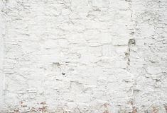 Abstract grungy empty background.Photo of white blank bricks wall texture. Blank cement surface.Horizontal. Stock Photos