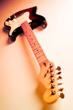 Abstract Guitar. Wide angle shot of an electric guitar with multicolour lighting Royalty Free Stock Image