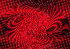Abstract halftone dots background in red colors Royalty Free Stock Images