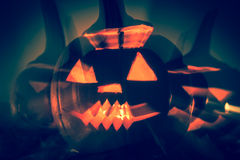 Abstract Halloween pumpkin lanterns dark light angry face fall b Stock Photos