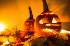 Abstract Halloween pumpkin lanterns dark light angry face fall b Royalty Free Stock Images