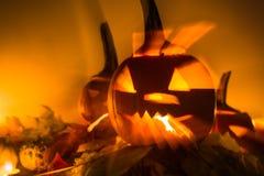 Abstract Halloween pumpkin lanterns dark light angry face fall b Royalty Free Stock Photography