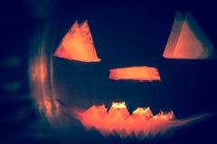 Abstract Halloween pumpkin lanterns dark light angry face fall b Stock Photography