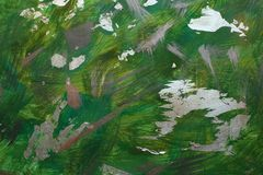 Abstract hand drawing green background with gold acrylic brushstrokes stock photography
