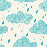 Abstract hand-drawn wavy cloud with raindrops. Vector seamless pattern Stock Images