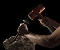 Abstract of hand hammer and hard rock isolated on black Royalty Free Stock Photos