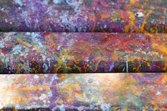 Abstract artistic background with splashes of paint. Abstract, hand painted colorful wooden background royalty free stock image