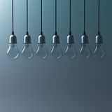 Abstract hanging light bulbs on dark green background with blank space Stock Photos