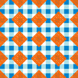 Abstract hard geometric seamless pattern in blue, orange and white colors.  Royalty Free Stock Image